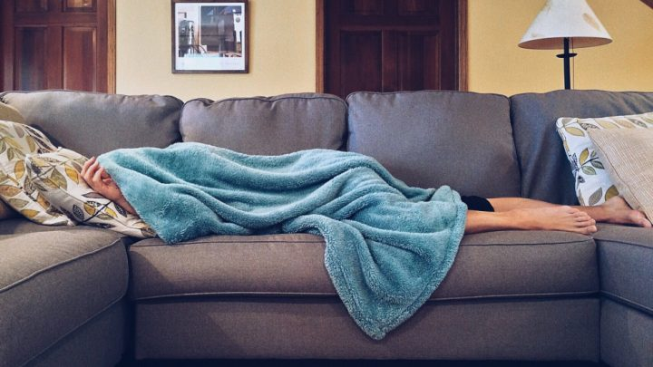 Person lying sedentary on a couch