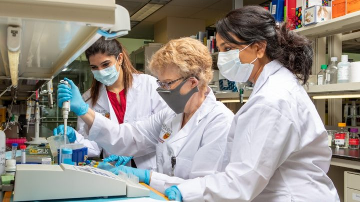 Alison Fox/Robichaud (middle) with researchers in the Taari Lab