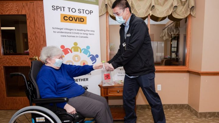 REsident in long-term care home doing a COVID spit test